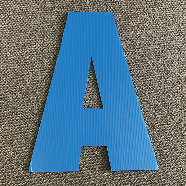 letter-a-blue-yard-greeting-card-sign-happy-birthday-over-the-hill-plastic