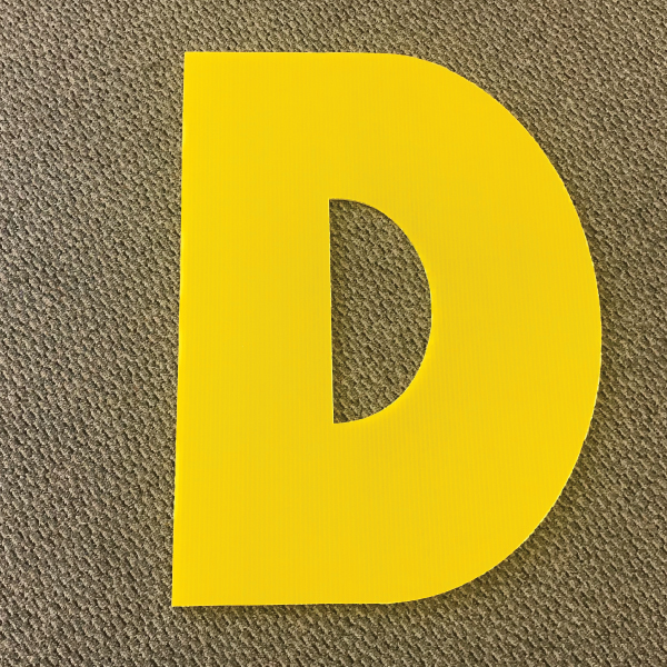letter-d-yellow-yard-greeting-card-sign-happy-birthday-over-the-hill-plastic