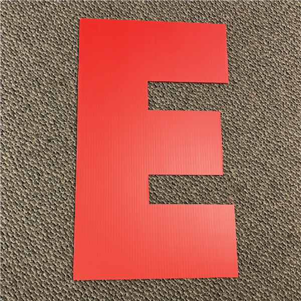 letter-e-red-yard-greeting-card-sign-happy-birthday-over-the-hill-plastic