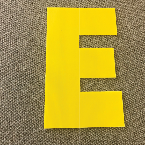 letter-e-yellow-yard-greeting-card-sign-happy-birthday-over-the-hill-plastic