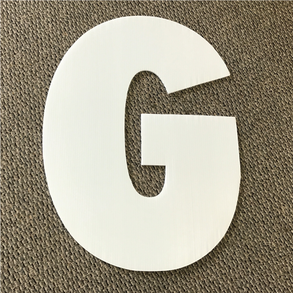 letter-g-white-yard-greeting-card-sign-happy-birthday-over-the-hill-plastic