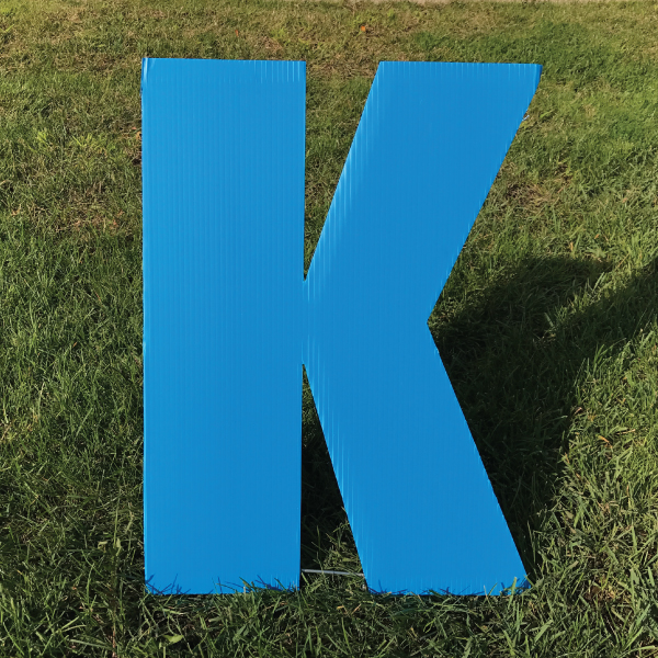 letter-k-blue-yard-greeting-card-sign-happy-birthday-over-the-hill-plastic