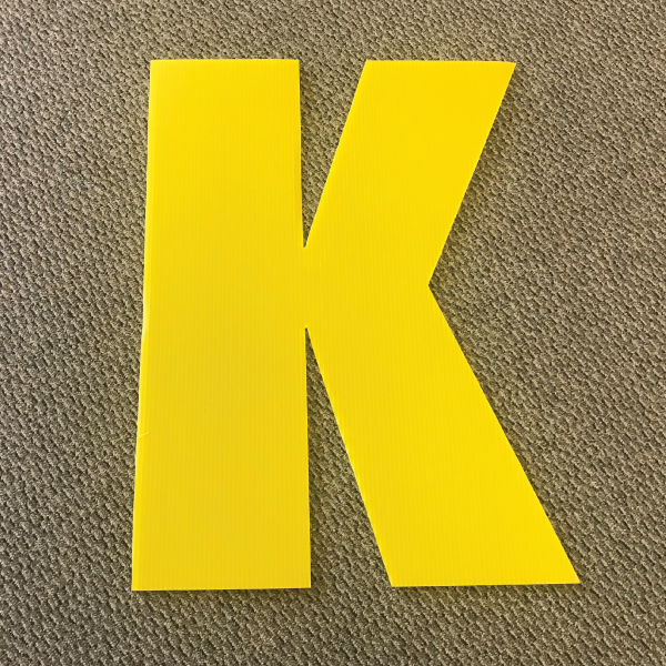 letter-k-yellow-yard-greeting-card-sign-happy-birthday-over-the-hill-plastic