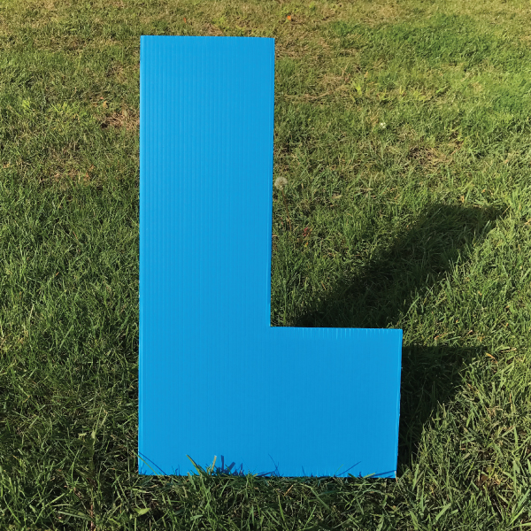 letter-l-blue-yard-greeting-card-sign-happy-birthday-over-the-hill-plastic