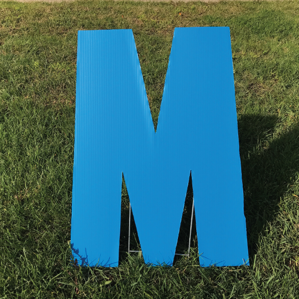 letter-m-blue-yard-greeting-card-sign-happy-birthday-over-the-hill-plastic