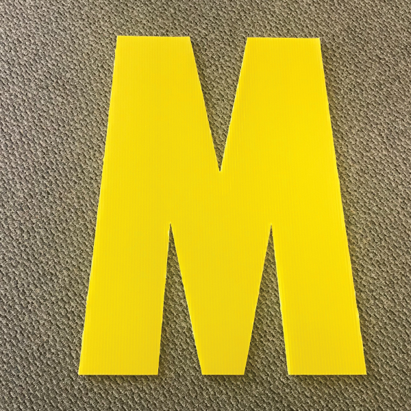 letter-m-yellow-yard-greeting-card-sign-happy-birthday-over-the-hill-plastic