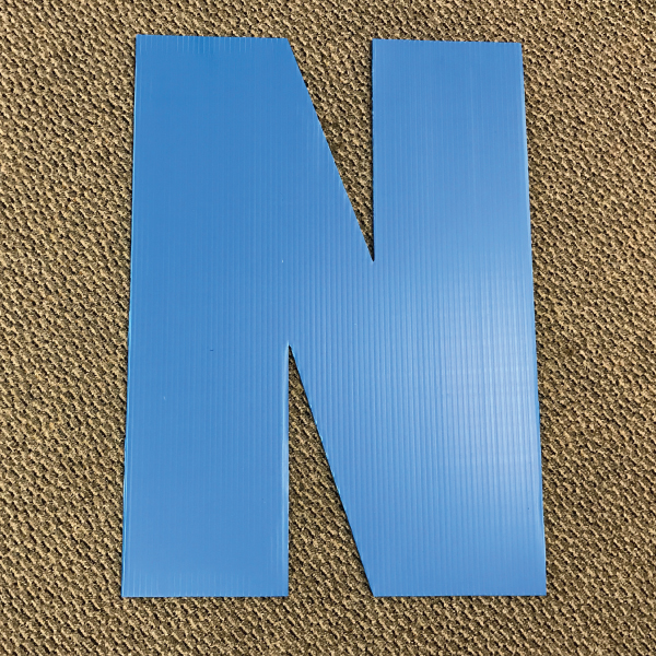 letter-n-blue-yard-greeting-card-sign-happy-birthday-over-the-hill-plastic