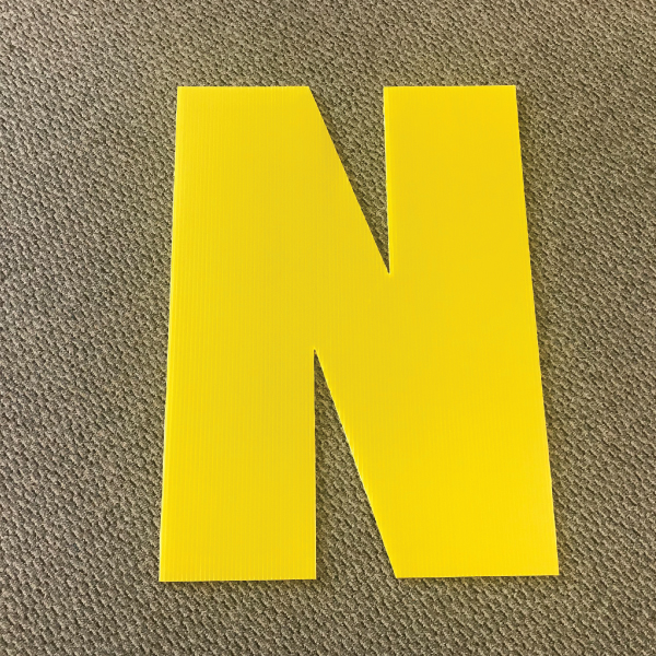 letter-n-yellow-yard-greeting-card-sign-happy-birthday-over-the-hill-plastic