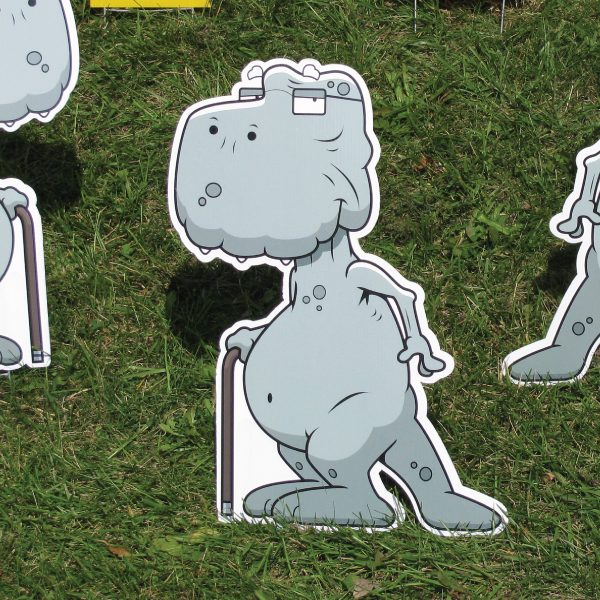 dinosaur_left_yard_greetings_cards_lawn_signs_happy_birthday_over_hill
