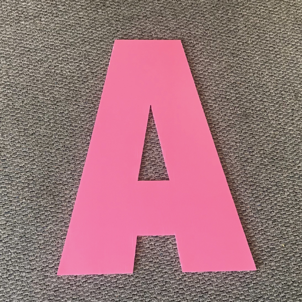 letter-a-pink-yard-greetings-cards-lawn-signs-happy-birthday-over-hill