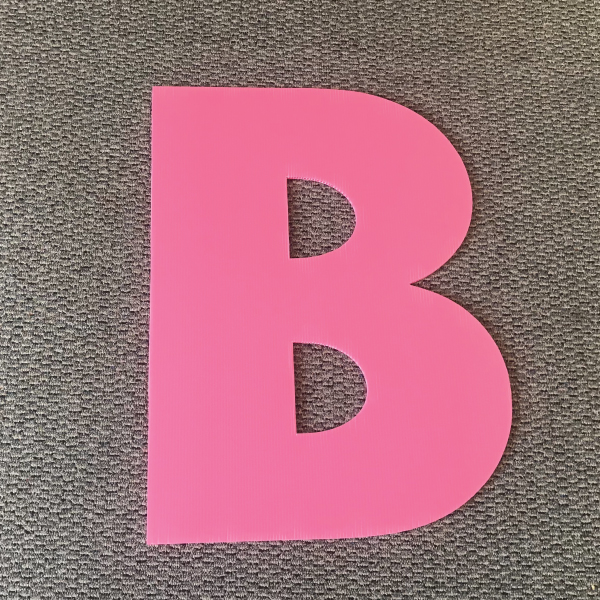 letter-b-pink-yard-greetings-cards-lawn-signs-happy-birthday-over-hill