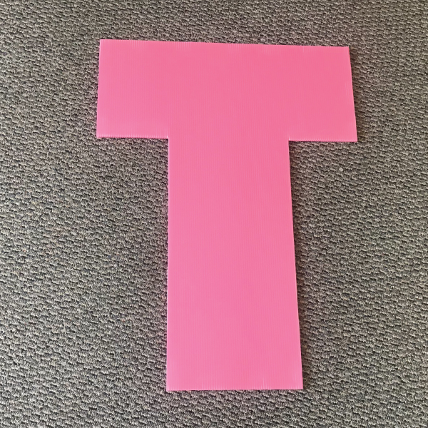 letter-t-pink-yard-greetings-cards-lawn-signs-happy-birthday-over-hill