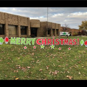 merry christmas yard greeting display with light bulbs