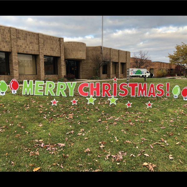 merry christmas yard greeting display with light bulbs